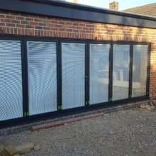 Vulcan black Smarts Aluminium bifold doors with integral blinds